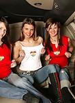 Three girls having fun in a limousine